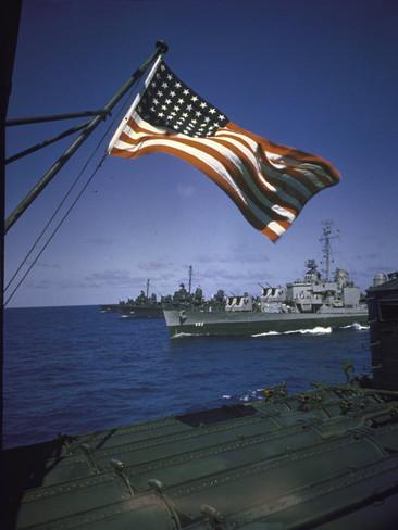 american-flag-flying-over-us-navy-ships-at-sea